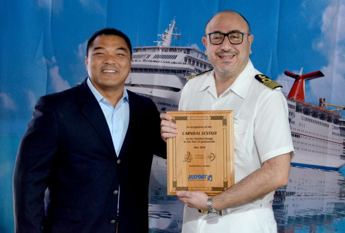 JAXPORT COO presents plaque to Carnival Cruise Line Captain