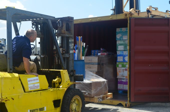 containers being loaded with relief supplies for Bahamas