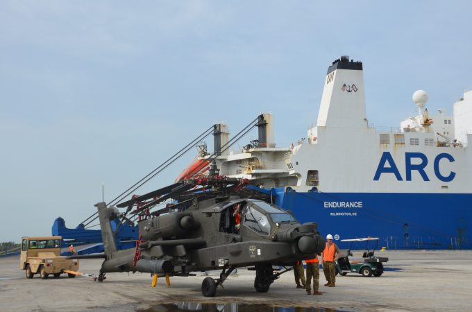 Helicopter being loaded onto a ship at JAXPORT
