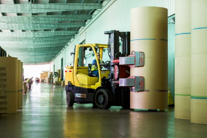 Forklift moving paper rolls at JAXPORT's Talleyrand Marine Terminal