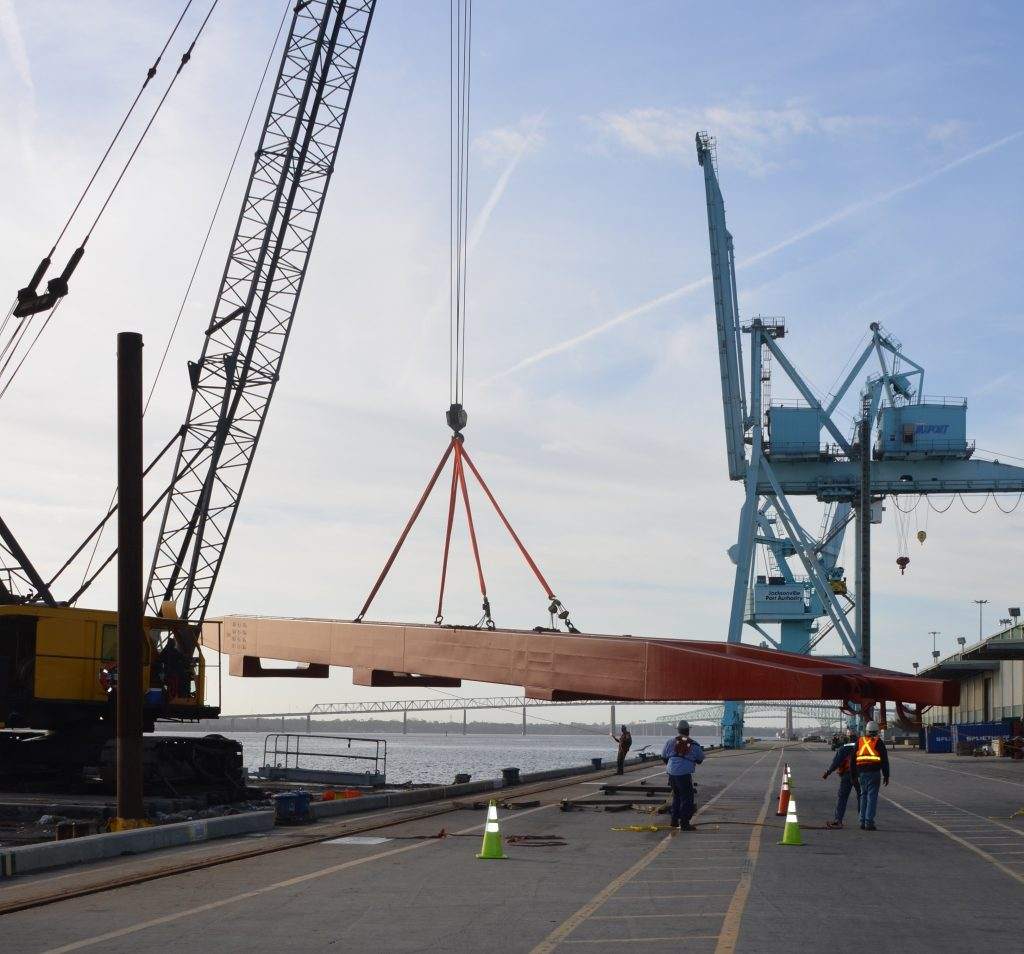 "Large crane part being moved off a ship and onto the dock at JAXPORT""s Talleyrand Marine Terminal."