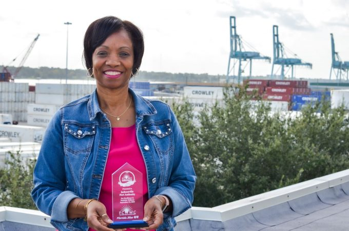 JAXPORT's wellness committee chair holds the port's wellness award