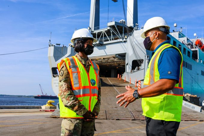 JAXPORT Chief Operating Officer Fred Wong speaks with a representative from the Military